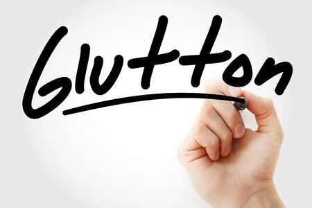 Hand writing Glutton with marker, concept background Zdjęcie Seryjne