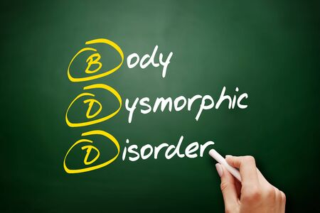 BDD - Body Dysmorphic Disorder acronym, health concept background Foto de archivo - 134858051