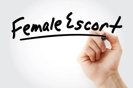 Hand writing Female escort with marker, concept background Stock Photo