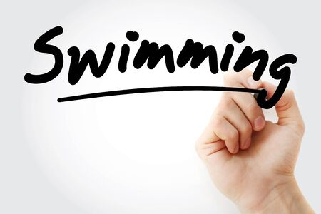 Hand writing Swimming with marker, concept background Stock Photo