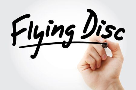 Hand writing Flying disc with marker, concept background Stock Photo
