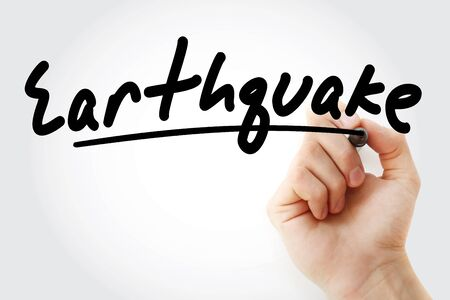 Hand writing Earthquake with marker, concept background Imagens - 135192878