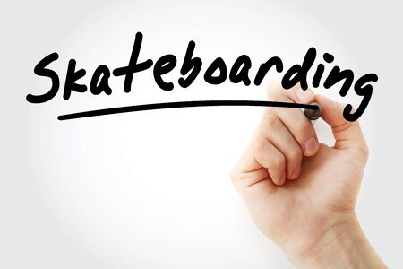 Hand writing Skateboarding with marker, sport concept background