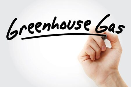 Hand writing Greenhouse gas with marker, concept background