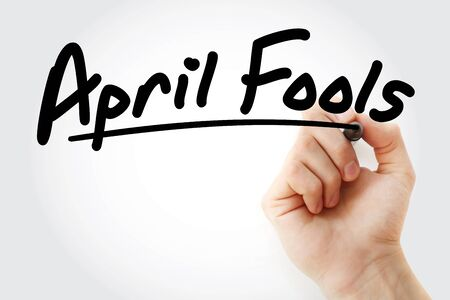 Hand writing April fools with marker, concept background Banco de Imagens