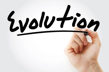 Hand writing Evolution with marker, concept background Stock Photo