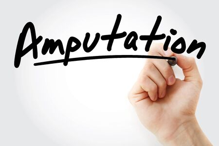 Hand writing amputation with marker, concept background Stock Photo