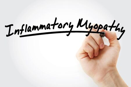 Hand writing inflammatory myopathy with marker, concept background