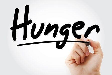 Hand writing hunger with marker, concept background