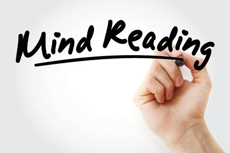 Hand writing mind reading with marker, concept background