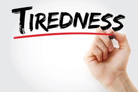 Tiredness text with marker, concept background Stock Photo