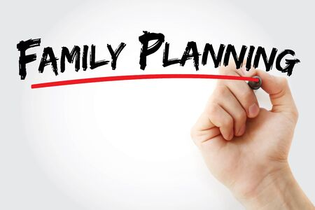 Family planning text with marker, concept background