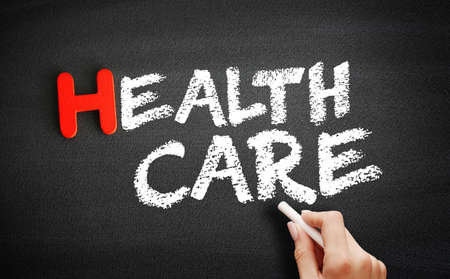 Hand writing Healthcare on blackboard, health concept background
