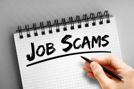 Job scams text on notepad, concept background Banque d'images