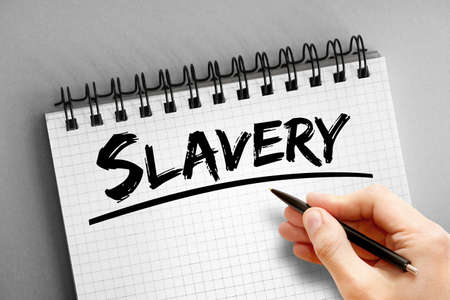 Slavery text on notepad, concept background