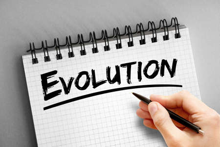 Evolution text on notepad, concept background