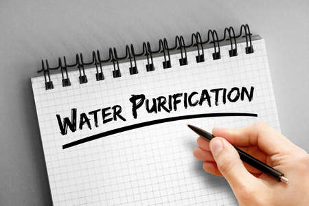 Water purification text on notepad, concept background