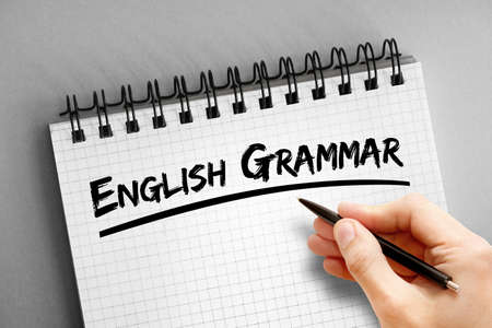 English grammar text on notepad, concept background