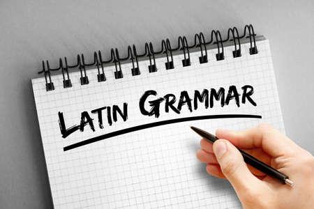 Latin grammar text on notepad, concept background