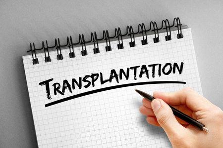 Transplantation text on notepad, concept background