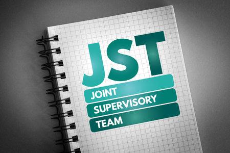 JST - Joint Supervisory Team acronym on notepad, business concept background Reklamní fotografie