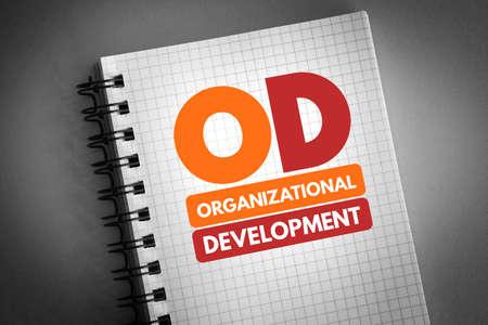 OD - Organizational Development acronym on notepad, business concept background