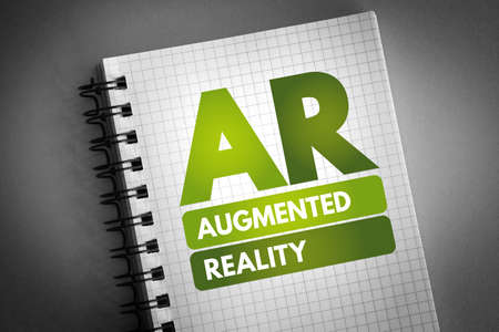 AR - Augmented Reality acronym on notepad, technology concept background