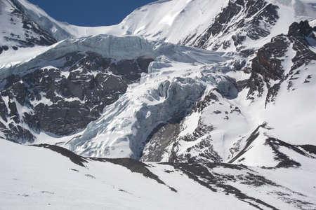 serac: Overhanging serac at the pass of Thorung La. Nepal Stock Photo