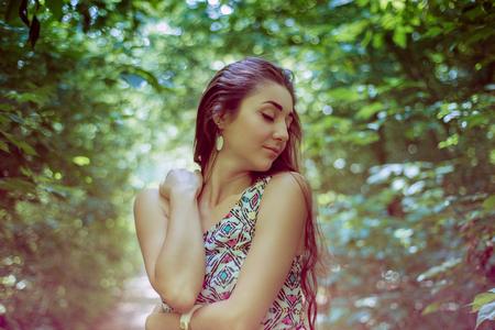 plein: portrait of beautiful long hair brunette on the plein air