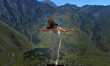 beautifu: beautifu brunette girl standing on mountain background