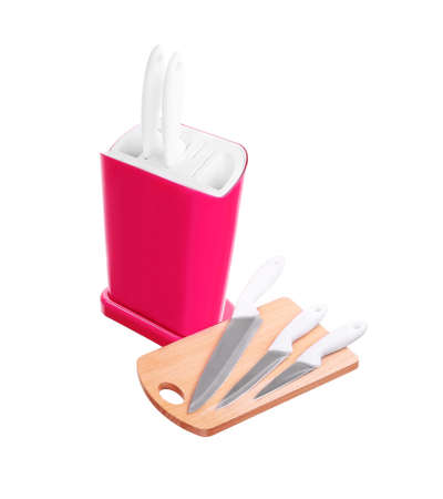 plastik: knife block with a wooden cutting board Stock Photo