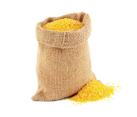 grits: Burlap bag with maize grits on white background Stock Photo