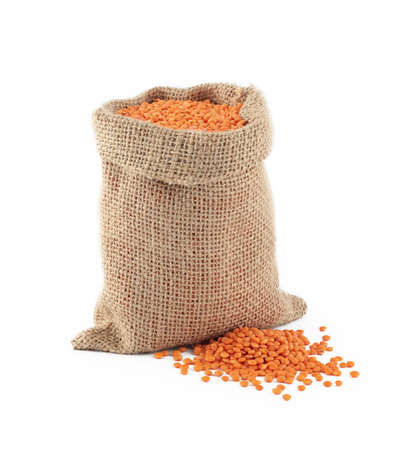 burlap bag: red lentils in a burlap bag on a white background Stock Photo