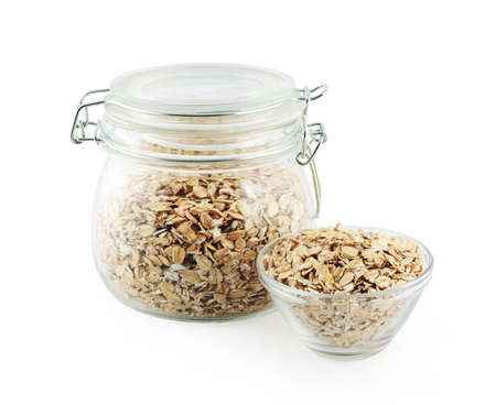 gass: gass bowl full of oat flakes isolated on a white