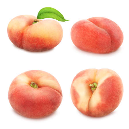 Set of flat peaches isolated on white. Full depth of field. Banco de Imagens
