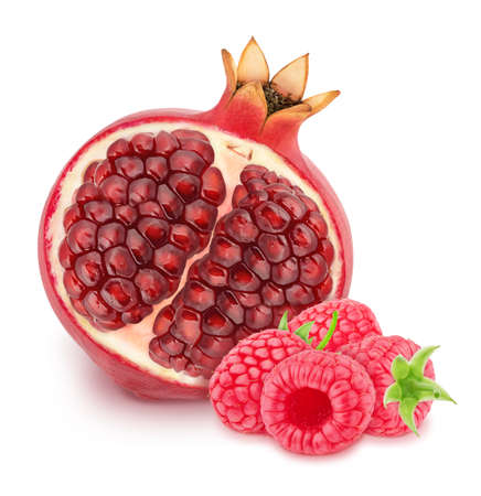 Composition with half of pomegranate and raspberry isolated on a white background. Antioxidant concept. Stock Photo