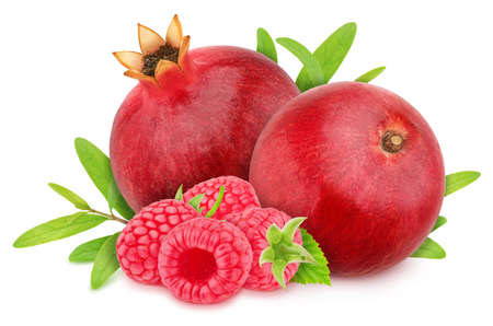 Composition with ripe pomegranates and raspberry with leaves isolated on a white background. Antioxidant concept.