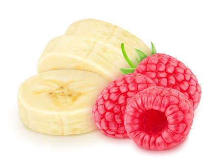 Composite image with halved banana and raspberry isolated on a white background.