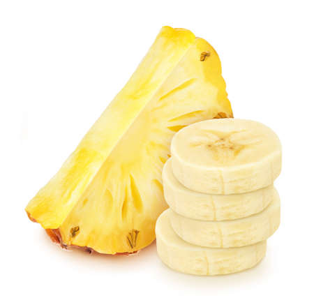 Composite image with heap of banana slices with the pineapple slice behind isolated on a white background.