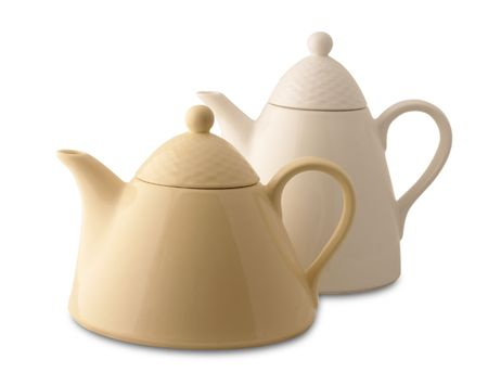 Two ceramic teapots isolated over white