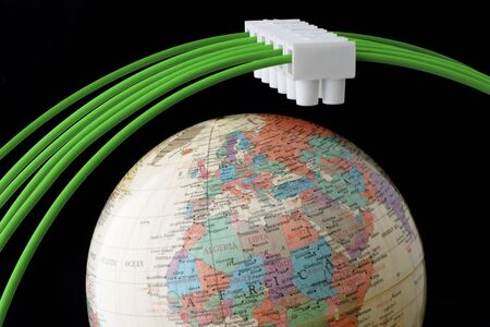Green electric wires and connector over globe Stock Photo - 6618069