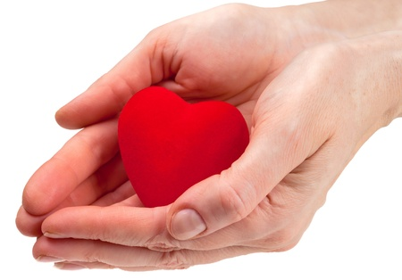 Heart symbol in hands Stock Photo