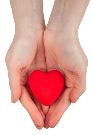 hands holding heart: Heart symbol in hands Stock Photo