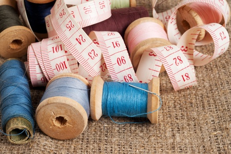needlecraft product: Old sewing items on canvas background Stock Photo