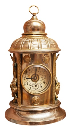 Antique brass clock isolated on white.