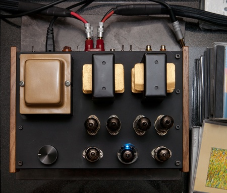 amps: Audiophile vacuum tube amplifier with cables and cd disks near