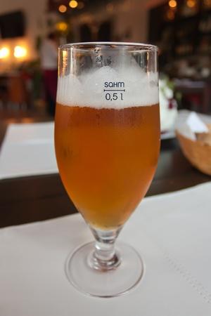alehouse: Pint of beer in restaurant interior