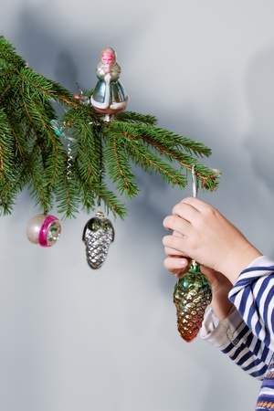 Retro ornaments on Christmas tree photo