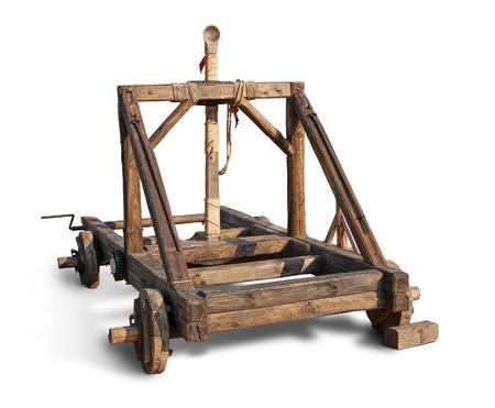 Wooden trebuchet catapult isolated over white.