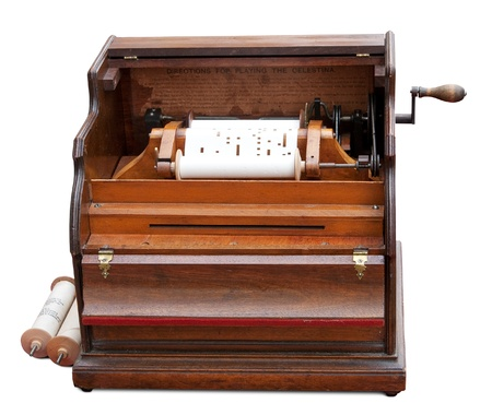 Vintage celestina (mechanical music box) and rolls with programs.